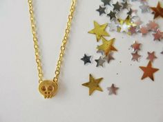Gold skull necklace by 53 Countesses