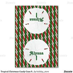 Tropical Christmas candy cane and sand dollars, red and green, tented place cards with name of guest on both sides.