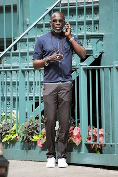 One way to add a little something extra to your warm-weather look? Dressed-down trousers. Just pair them with something sporty (like Michael K. Williams' short-sleeve zip-up) to keep things feeling casual.