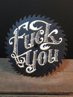 "Fuck You 10"" hand painted circular saw blade by Cindy Magee (Crow Studio). Painted with professional lettering enamels."