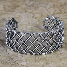 "Britannia metal bracelet, handmade in the U.S.A. by Oberon Design, offering a variety of bracelet styles. - Lead free, food grade Britannia metal Dimensions: - Width: 1.0"" - Weight: 37.4 grams Sizing:"