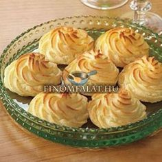 Duchess Potatoes Recipe _ A great choice for entertaining, Duchess Potatoes are cooked potatoes that are blended with egg yolks, butter and cream, piped into a decorative shape and baked. Serve with beef tenderloin or a pork roast for an impressive meal. Cheap Side Dishes, Potato Ricer, Creamed Potatoes, Baked Potatoes, Good Food, Yummy Food, Yummy Recipes, Recipies, Cooking