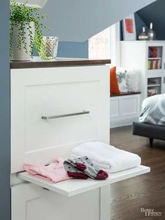In addition to the storage space in the cabinet, a pullout ledge is handy for folding clothes or elevating a laundry basket./