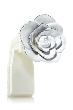 White Rose - Wallflowers Fragrance Plug - Bath & Body Works - Finish any room with a romantic rose! Pair with your favorite Fragrance Refill for refreshing home fragrance. A quick twist of the rotating plug lets you choose a vertical or horizontal outlet.