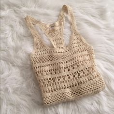 Crochet Empyre Top Beige crochet tank top by Empyre. Only used a couple times and it's in excellent condition.   » Offers through the offer button  » Bundling discounts available  » No trades Empyre Tops Tank Tops