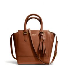 The Legacy Mini Tanner Crossbody In Leather from Coach.  Not huge on coach but I love this bag in this color.