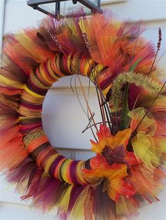 Autumn/ Fall Tulle Wreath!!! If you want to make this wreath look at my candy cane wreath or the bubble gum wreath and there is instructions on how to make it :)
