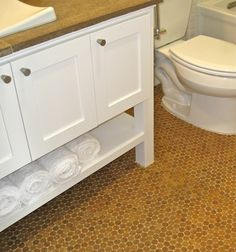 LOVE LOVE LOVE!!! cork penny tile bathroom floor...mold/mildew resistant.