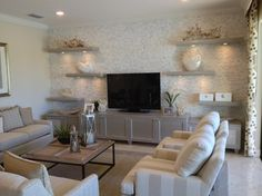 """Riverstone"" models inspirational pictures.  Stacked stone, floating shelves contemporary-living-room"