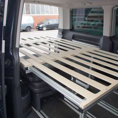 We built a new bed for a multivan that fits right over one backseat and can be pushed together t - bullifaktur Caddy Camping, Stealth Camping, Minivan Camping, Jeep Camping, Camper Beds, Bus Camper, Honda Element Camping, Campervan Bed, Kombi Home