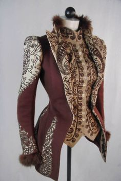 Wine and Ivory Jacket  Jacket made of heavy wool in wine and cream. Tight fitting, hip-length jacket with stand-up collar. Front attached vest is ornately trimmed with maroon machine embroidery. The same trim is found on the shoulder, bottom of sleeve and on the back. Skirt of the jacket is shaped to fit over a bustle. c. 1890s.    The jacket was worn by Jessie Webb Corwin's mother, Jessie Mason Webb.      c. 1890s