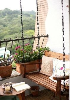 Hanging bench at one end with side table and perennial greenery.