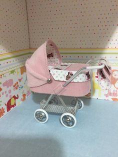 1/12th scale modern dolls house pram/stroller/buggy pink needlecord with cute mouse lining in pink and white hand crafted miniature