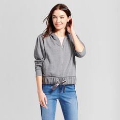 If the weather demands only a sweater, or you're always cold even when indoors, the French Terry Hoodie Jacket from A New Day™ is the perfect extra layer. The classic hoodie with an elastic waist lets you cinch it to keep warmth in and the cold out. Endlessly styleable, this zip-up hoodie with pockets is a casual piece that looks great over any outfit.