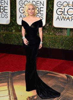 Lady Gaga, in a custom Atelier Versace dress, attends the 73rd Annual Golden Globe Awards in Los Ang... - Jordan Strauss/Invision/AP