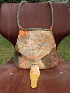 This nuno felt purse by Vanda Roberts is a steal from Etsy at $50.00!!! I was lucky enough to take a workshop with Vanda in Ireland several years ago, her work is AMAZING!