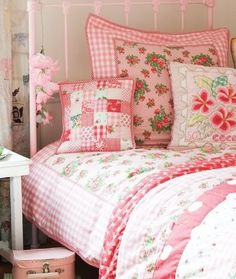 Pink bedroom with gingham and floral quilt