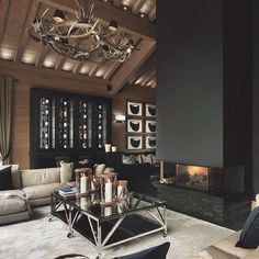 Pretty glamourous idea for a chalet, with the chrome and black... although I'd personally like to see something on the fireplace!