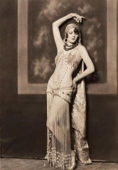 Very sexy looking lady even for someone from the 1890's. Vintage belly dance costume.