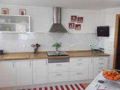 Transformación de cocina sin obra, cambio de puertas armario, encimera de madera roble .