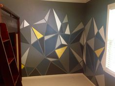 Geometric vector mountains wall for the boy's room, blue, grey, yellow painted with frog tape