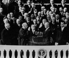 Dwight D. Eisenhower takes the Oath of Office as the President of the United States during his Inauguration January 20, 1953 in Washington D.C. Also pictured is former president Harry S. Truman and Richard M. Nixon.