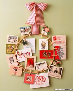 Christmas card display - clip to large embroidery hoop. I would paint or modge podge the clothes pins first.