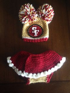 This is a Newborn baby girl 49ers crochet outfit. Its ready to ship. Read my policies on baby hats before ordering. This is for the average