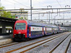 New s-train ariving in effretikon. Then the train departs to brugg