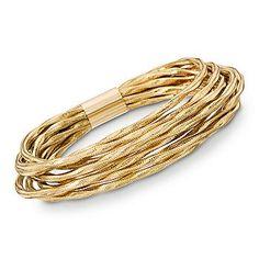 A shimmering texture brings a charming feel to this elegant bangle. Italian Nine-Strand Flex Bangle Bracelets