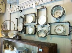 Sterling silver servers on the wall  make a eye catching display.