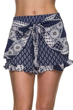 Welcome Spring in this super stylish pattern print shorts with front tie detail and ruffled hem. 100%Rayon