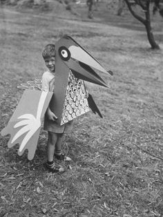 Bird toy/costume by Charles Eames, photo by Allan Grant for LIFE Magazine, 1951 Charles Eames, Cardboard Costume, Bird Costume, Flo Costume, Spider Costume, Do It Yourself Inspiration, Miss Moss, Bird Toys, Life Magazine