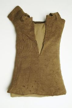 Knitted woollen vest with short sleeves made of brown wool. Knitted shirts or vests are mentioned in a list of knitted items in an act of 1552 limiting the times of year that wool could be bought and sold. This child's knitted wool vest was found at Finsbury in London. This vest is a rare survival of a knitted garment from this period. It is seamless, suggesting it was knitted on four needles, a very old technique.    Date:  1501 AD - 1599 AD