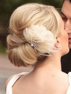 Twisted wedding updo with flower- maybe just something like this.  feels more modern.  veil might be too much for this setting