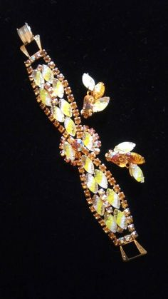 Vintage Juliana Rhinestone Jewelry Set, - Yellow & Topaz Demi Parure - High End Bracelet Earring Set - Old Hollywood Glamour Brought to you by MartiniMermaid on etsy  Style: Mid Century Color: yellow, topaz rhinestones & gold tone metal Size: 7 1/4 inches long by 1 1/4 inches wide #juliana #rhinestones #yellowstones