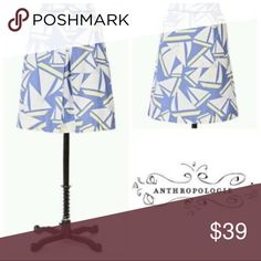 """Anthropologie Odille sailboat nautical skirt Cotton """"Genoa & Jib"""" sailboat print skirt. Light blue background covered in white and yellow sailboats. Inverted pleat in the front, and two side pockets. Waist band and pockets have navy piping and stitching. Hidden inside zipper and hook closure.  Measures 14.25 inches across the waist, 22 inches length.Excellent condition! Anthropologie Skirts A-Line or Full"""