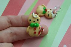 This cute Gingerbread couple is made using polymer clay and finished with glaze for shine and protection. Each gingerbread measures an inch in height and are attached to hook earrings. The material is very light weight and would make the perfect accessory for the Holiday. This