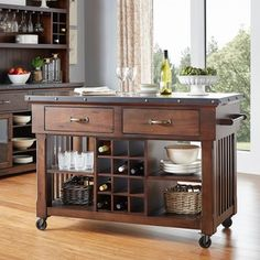 Complete the look of your kitchen with the gorgeous Norwood 2-drawer Kitchen Cart with Wine Rack. This charming piece serves you with a variety of purposes! Its spacious shelving is perfect for cookbo