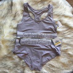 NWT Calvin Klein bra and panty set Gray stone color set by CK. Large logos. Top racerback bralette. Hipster bottoms. Both size mediums. No trades. Calvin Klein Intimates & Sleepwear Bras