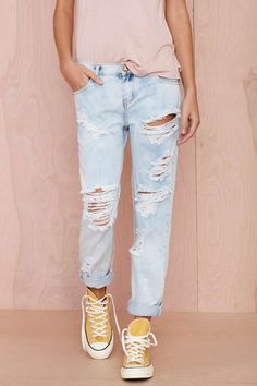 Ripped jeans lose top and converse= perfect summertime outfit the light colours and looseness of the clothes means you can stay cool in style