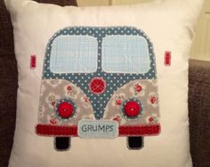 This lovely camper cushion is handmade in the UK and made from a selection of different fabrics. Each piece is individually sewn on to the cushion