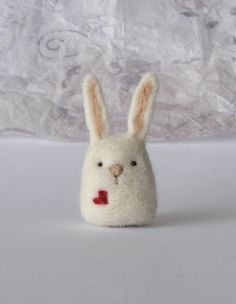 * This is a made to order creation. As it is a handmade item each is unique and may differ a little from the photos. A cute needle felted wool bunny with a heart. This little white bunny is made of sheep wool. It is about 2.6 inches / 6.5cm tall from bottom to the top of its ears, and