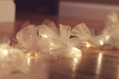 DIY wedding decorations.  Tulle, lace and white Christmas lights.