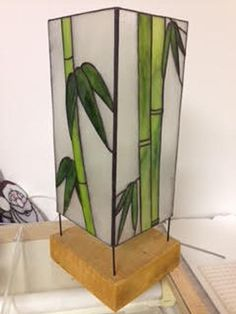 This is a handmade bamboo stained glass lamp, made using several art glass manufacturers including the Youghiogheny dotted glass. This listing is for the lamp and base. We use nothing but the best possible materials in all of our parts Stained Glass Lamps, Stained Glass Designs, Stained Glass Projects, Stained Glass Patterns, Shabby Chic Candle Holders, Glass Candle Holders, L'art Du Vitrail, Lanterns, Vase
