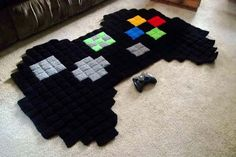 Giant 8 Bit Xbox Controller Rug by harmonden on Etsy Etsy shop Harmonden sells crochet rugs featuring characters from popular video games like Super Mario Bros.mon, The Legend of Zelda, Megaman, and Minecraft. The rugs are available to pu. 8 Bit Crochet, Crochet Rugs, Crochet Geek, Blanket Crochet, Crochet Squares, Crochet Granny, Crochet Gifts, Crochet Pokemon, Granny Squares
