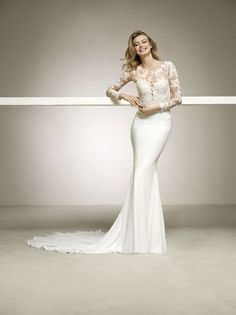 Dalas by Pronovias. Dalas is a slim fitted bridal gown with an illusion lace bodice and full length lace sleeves. Wedding Dresses London, Bridal Wedding Dresses, Bridal Style, Pronovias Dresses, Pronovias Wedding Dress, Debutante Dresses, Designer Wedding Gowns, Living At Home, Dresses Uk