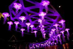 origami, is fused with modern sensory technology in this interactive light installation called Jelly Swarm