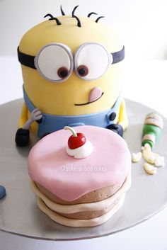 I'm going to have to make this with polymer clay...Despicable Me Minion Cake by Bake-a-boo Cakes NZ, via Flickr