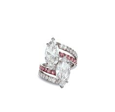 Of crossover design, claw-set with two marquisecut diamonds, weighing approximately 3.08 and 3.01 carats, to the brilliant-cut pink diamond and diamond shoulders, mounted in 18k white gold, ring size 6. Accompanied by the report no. 2145626071 dated 17 April, 2012 from GIA stating that the 3.01 carat diamond is D colour, SI1 clarity. Accompanied by the report no.2145521858 dated 02 April, 2012 from GIA stating that the 3.08 carat diamond is E colour, VS2 clarity.